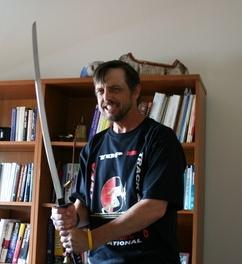 JeffH with sword, in office.